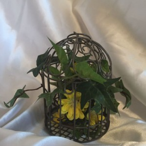 caged flower arrangement