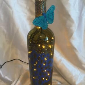 flower lighted wine bottle